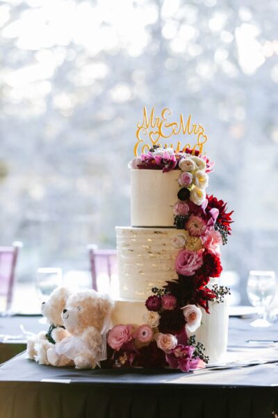 Bridal cake decorated with fresh flowers
