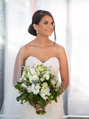 bride holding classic style flowers
