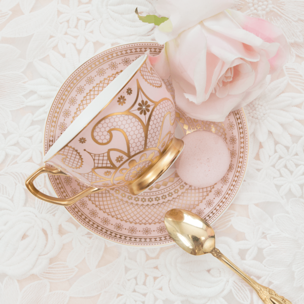 pale pink tea set with gentle lace pattern
