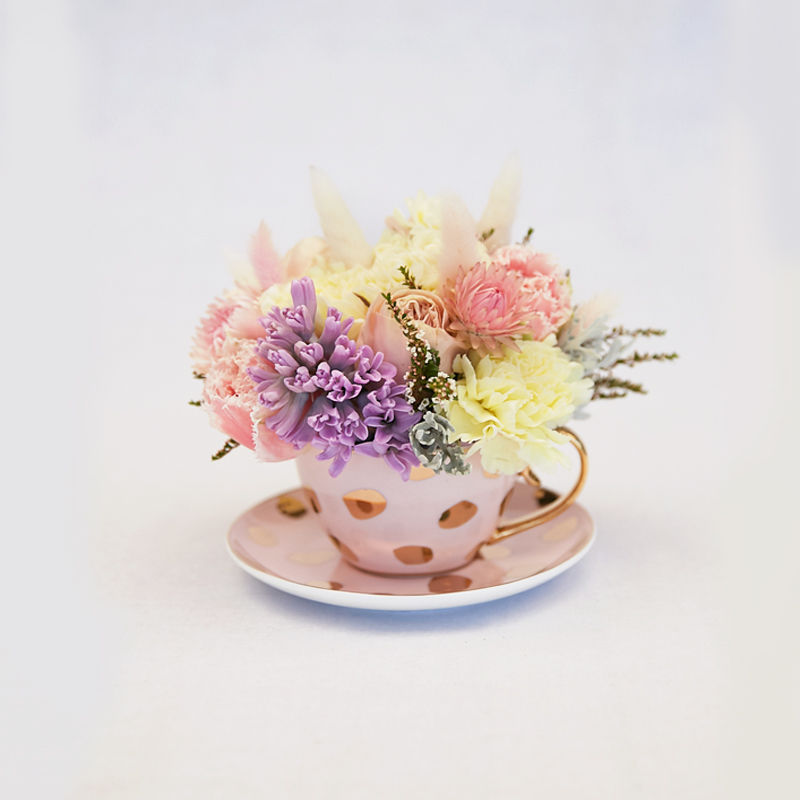 Unique gift ideas, flower posy in a tea cup
